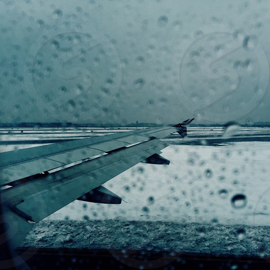 airplane wing in the rain photo