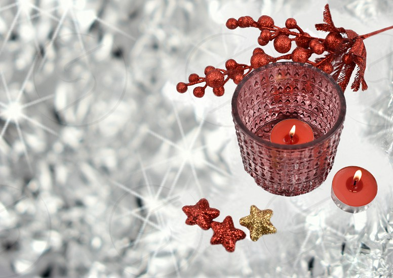 Silver red festive background. Red christmas decoration on a silver background. Elegant holiday still life photo