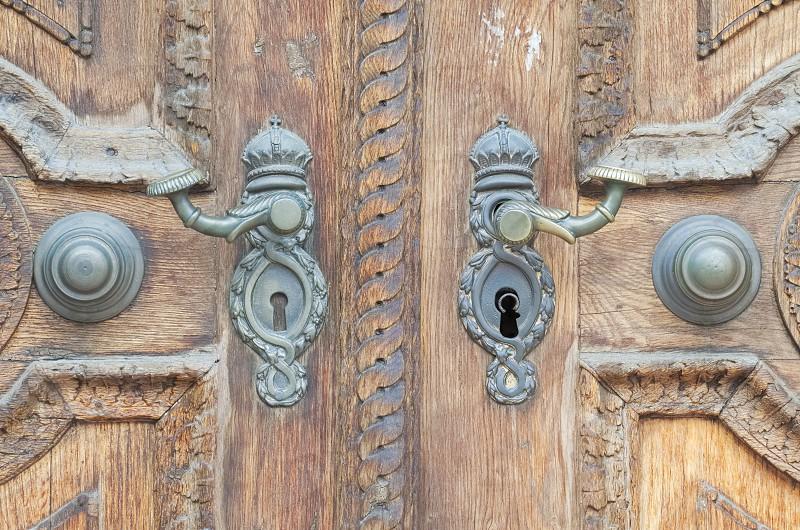 Old Wooden Door with Metal Handle Closeup photo