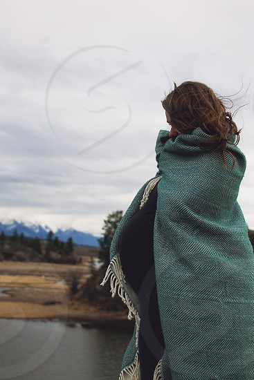 maternity woman pregnancy belly baby bump woman blanket turquoise outdoor mountain photo