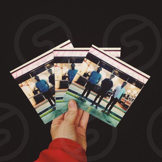 human holding pictures of people photo