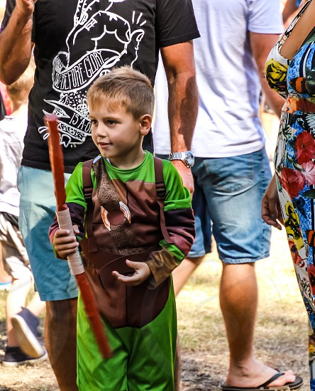 little boy in costume at a festival  photo
