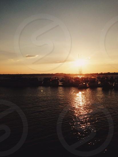 boats docked at sunrise photo