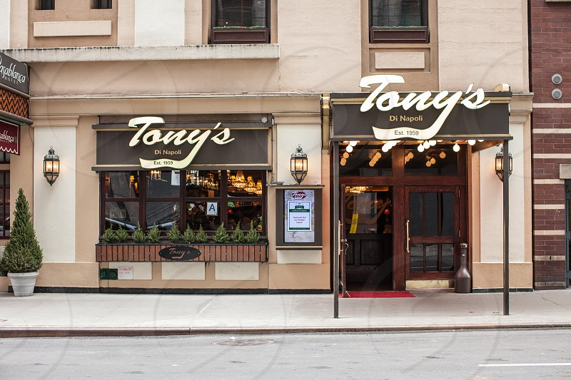 tony's store with lights turned on at daytime photo