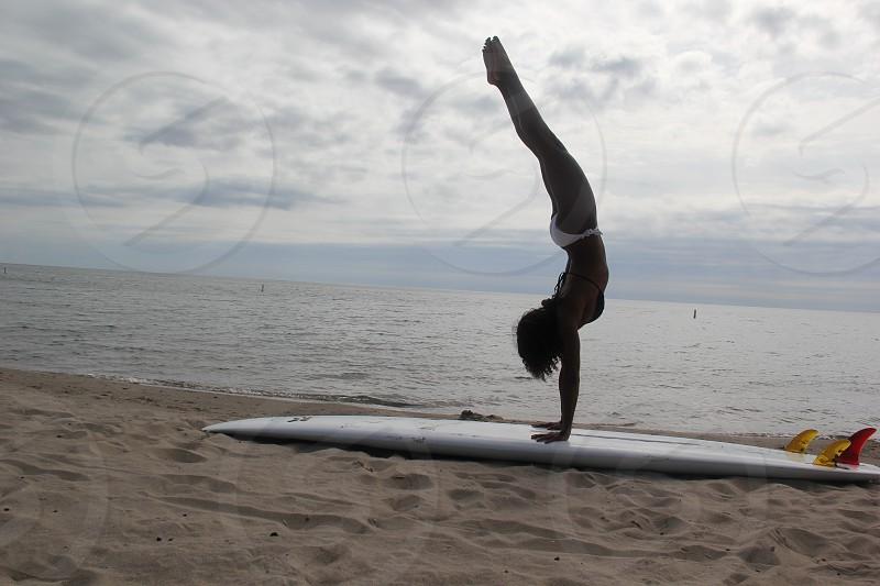 Surf model handstands bikini light surfboard beach woman  photo