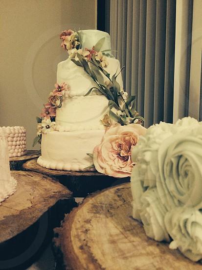 3 layered white cake with flower design photo
