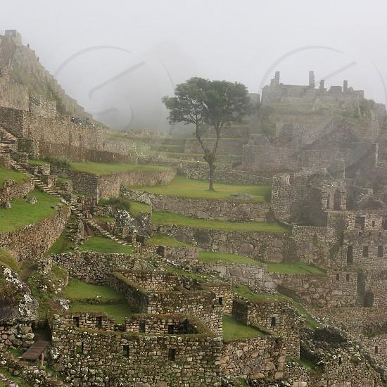 Ruins of Machu Picchu Peru in the Fog  photo