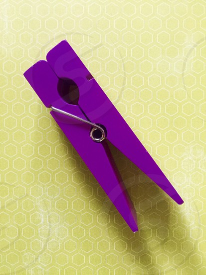 Large Purple Paper Clip On Spring Green Paper photo