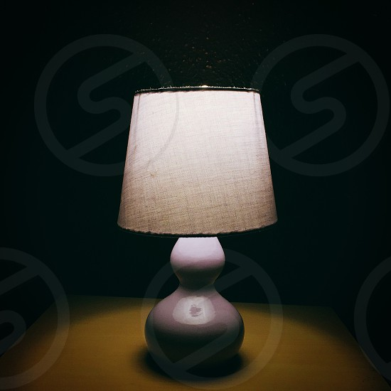 purple and white table lamp turned on photo
