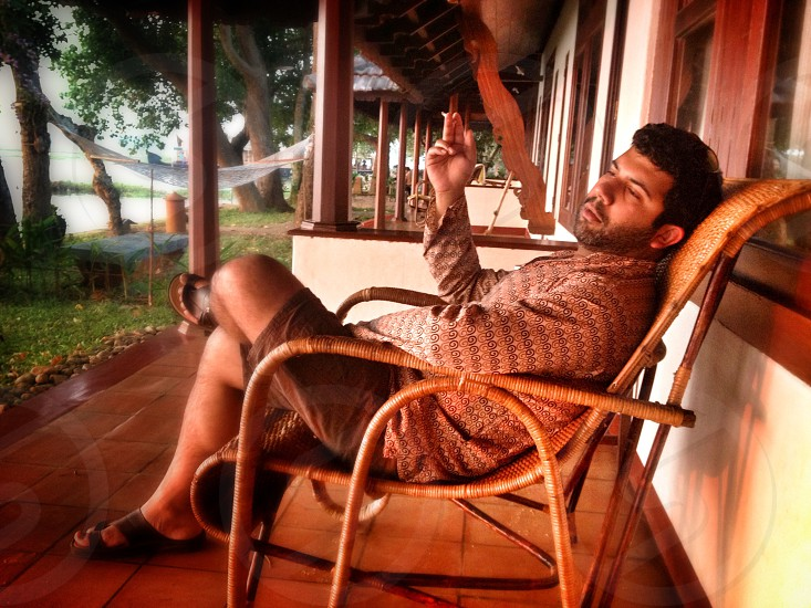 Man relaxing Kerala India Backwaters Coconut Lagoon photo