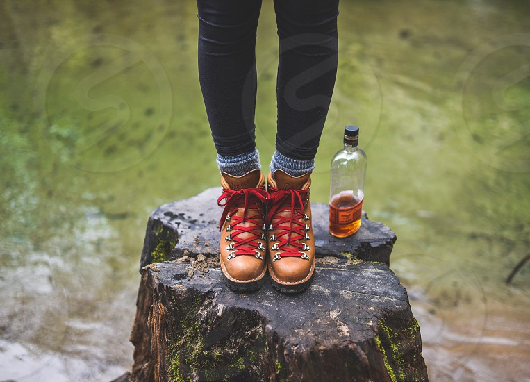 shoes boots leather red whiskey bourbon river creek camp glamping hipster fashion hike outdoors apparel  photo