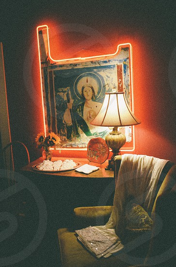 white table lamp near religious figure wall decor photo
