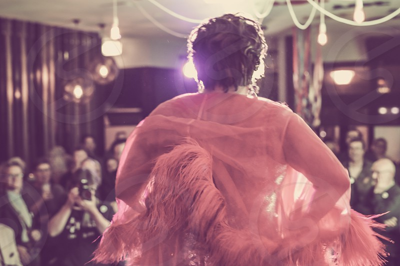 cabaret performer on stage performing photo