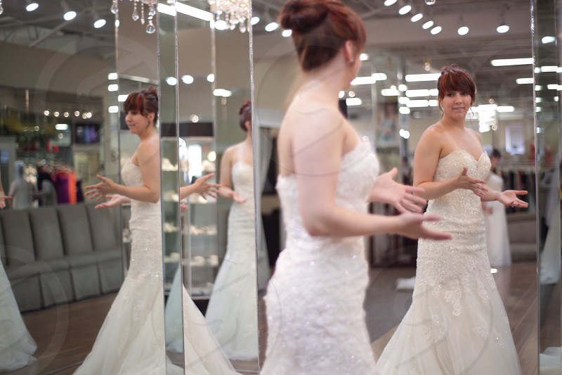 clear glass mirror reflecting woman in white gown photo