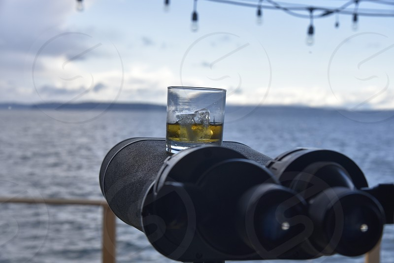 Whisky on ice on binoculars  photo