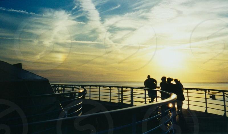 Cruise ship at sunset photo