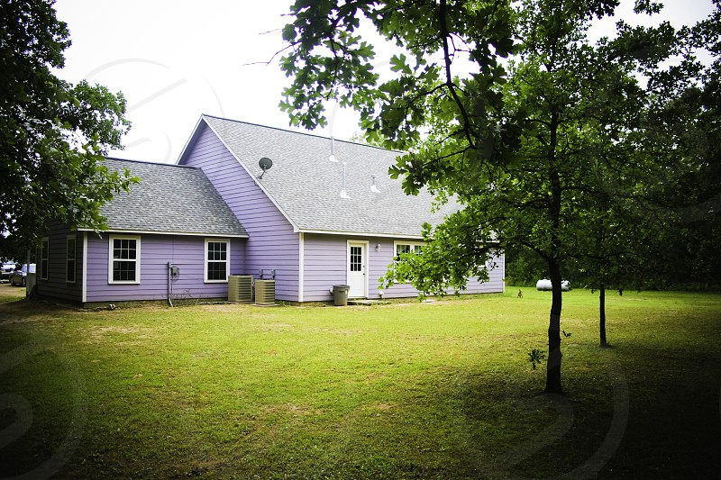 purple painted wooden house photo