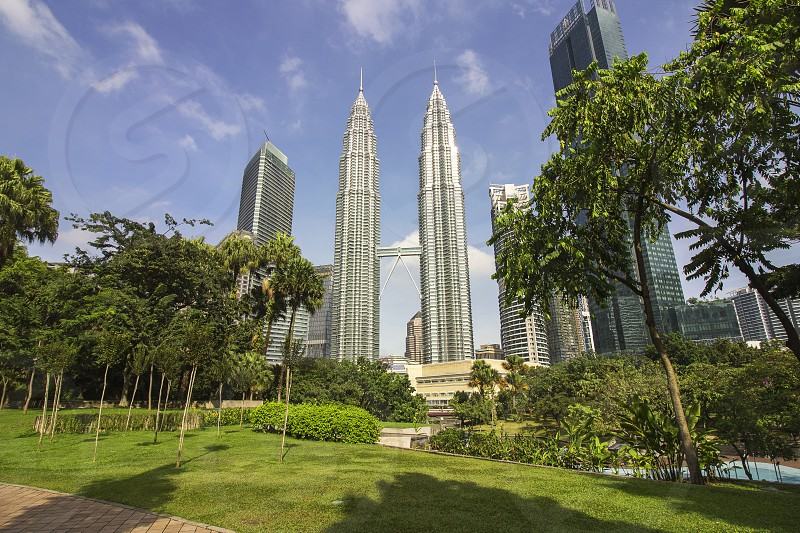 petronas twin towers in Kuala Lumpur is surrounded by klcc park photo