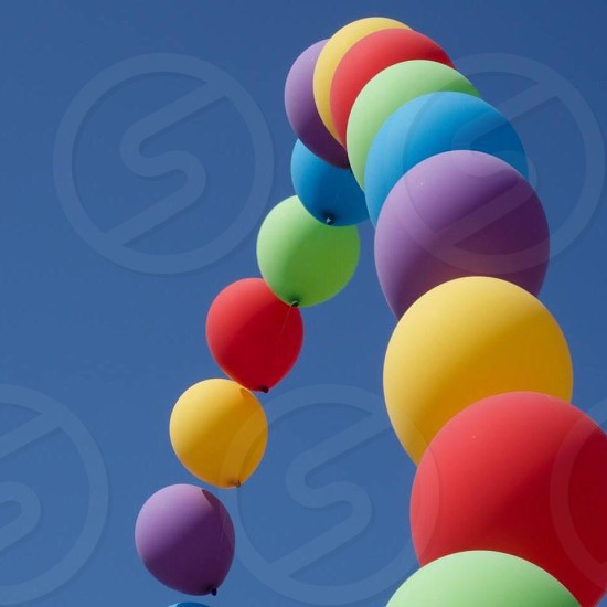 Rainbow balloons Special Olympics blue sky looking up point of view Celebrating LGBT as well photo