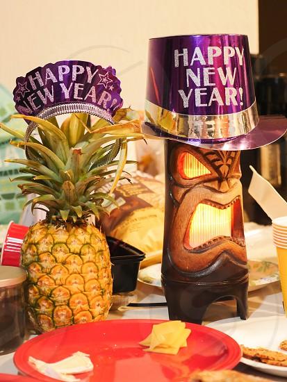 Happy new year decoration tiki pineapple party Hawaii photo