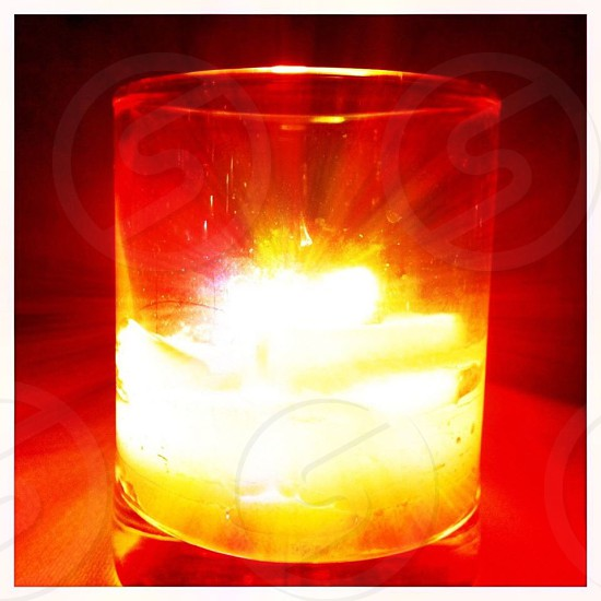 clear glass with turned on tealight photo