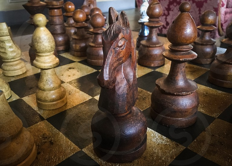 brown and black wooden chess pieces photo