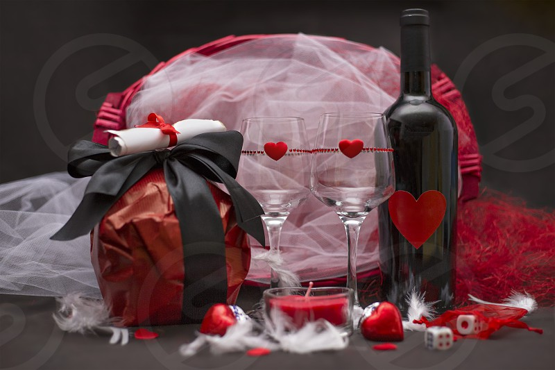 Love game with game dice glasses chocolate wine bottle and candle for a special party for two Valentine's day photo