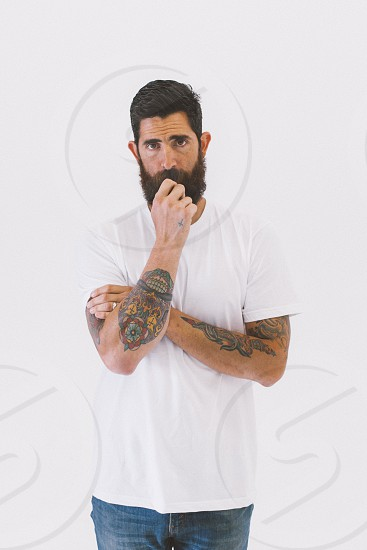 man with tattoos and white t-shirt photo