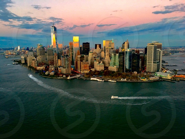 New York Usa Manhattan aerial sea harbor One world trade center skyscraperscityscape sunset orange sky photo