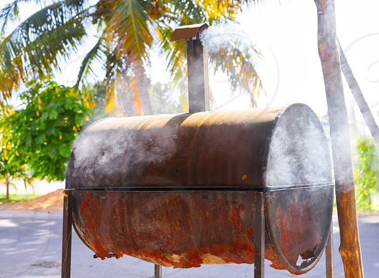Aged rusted iron barrel barbecue in Mexico Riviera Maya photo