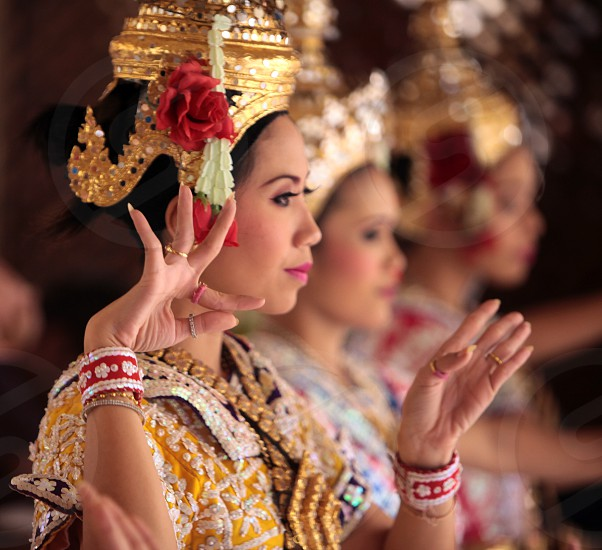 traditional Thai Dancers at the Erawan Shrine in the city centre at the pratunam aerea in the city of Bangkok in Thailand in Suedostasien. photo