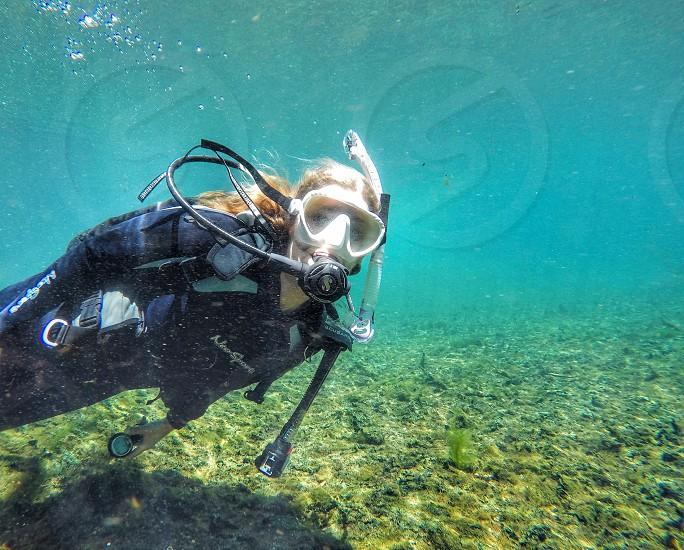 My morning dive. Girl diving ocean underwater sports scuba scuba diving. photo