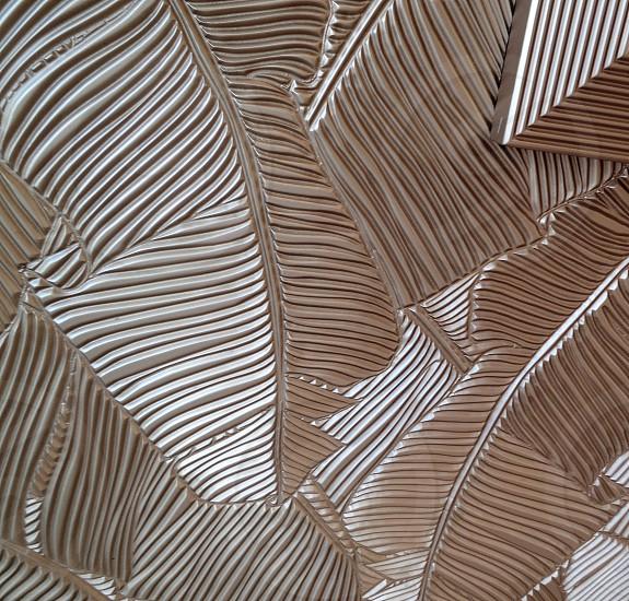 Carved metal palm leaf design on a building in Bal Harbor Florida photo