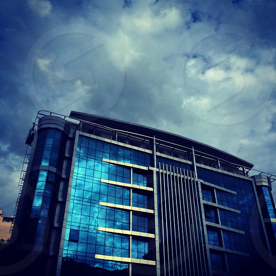 blue tinted glass building photo