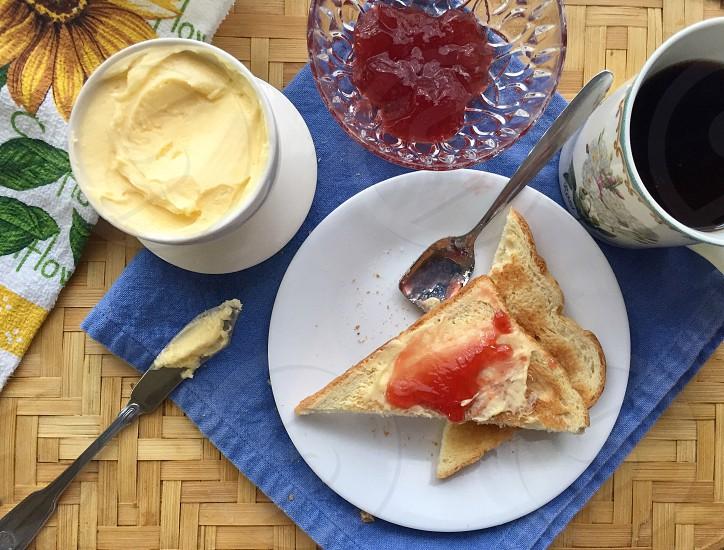 Breakfast toast jam butter coffee photo