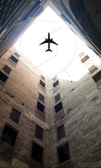 Looking up to a plane passing  photo