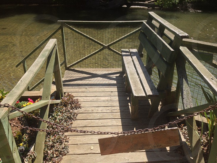 brown wood deck with bench photo