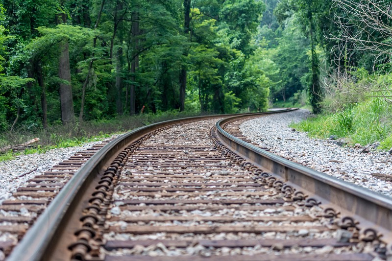 pattern repetition repeat texture railroad tracks rail board rock metal forest trees perspective photo