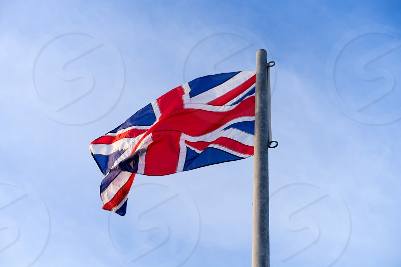 Union jack or united kingdom flag flying on steel pool photo