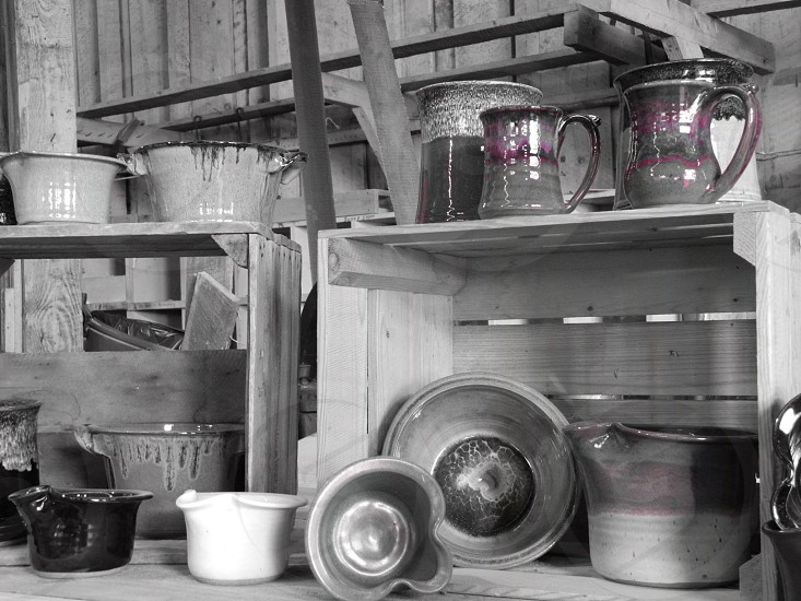 gray-scale photography of white bucket on shelf photo