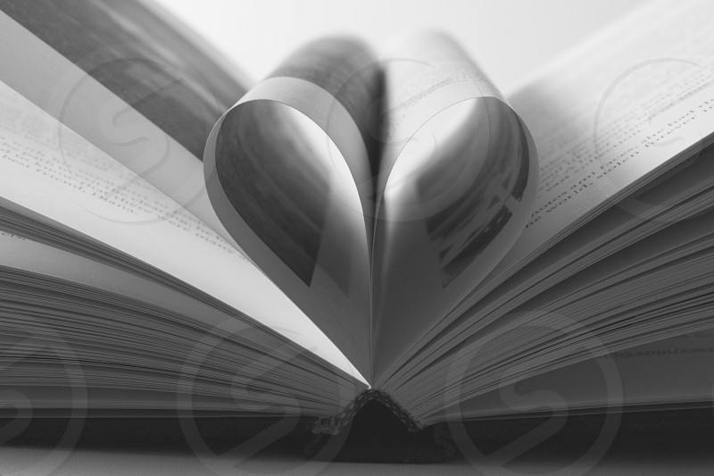 book pages forming heart in grayscale photo