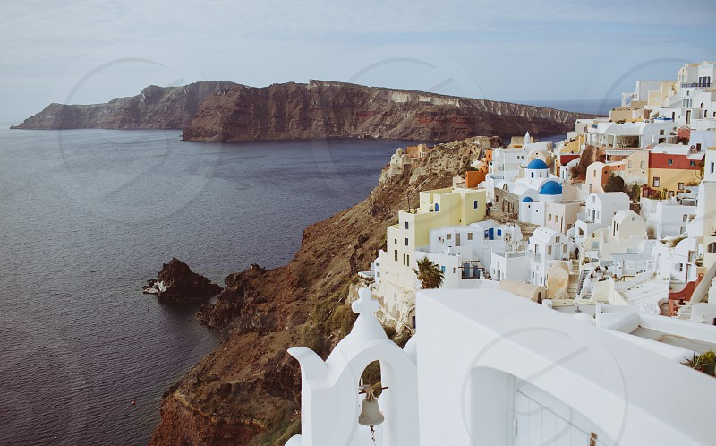 santorini europe travel location destination architecture nature landscape beautiful rocks ocean summer sun greece holiday honeymoon bell white blue brown orange day  photo