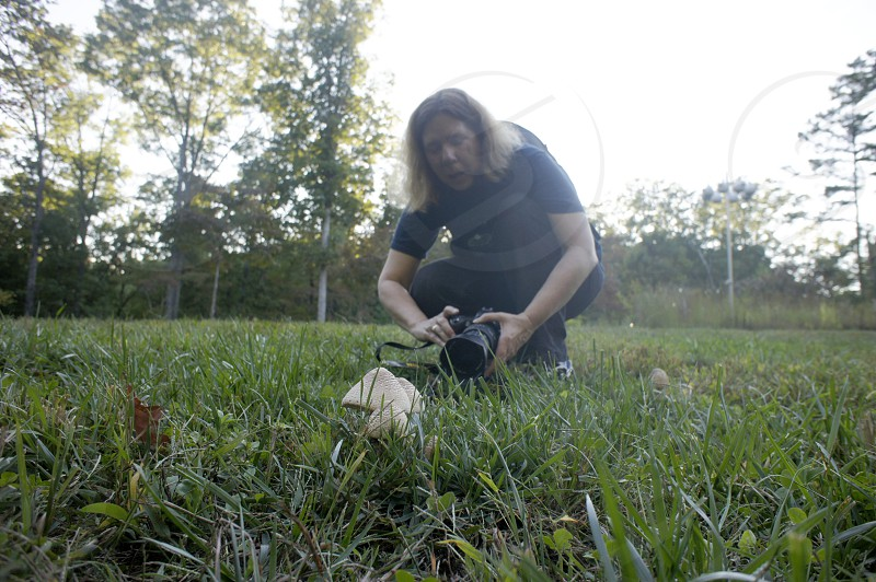 Getting on the ground to photograph mushrooms photo