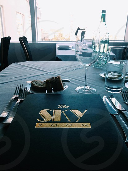 the sky room menu on table photo