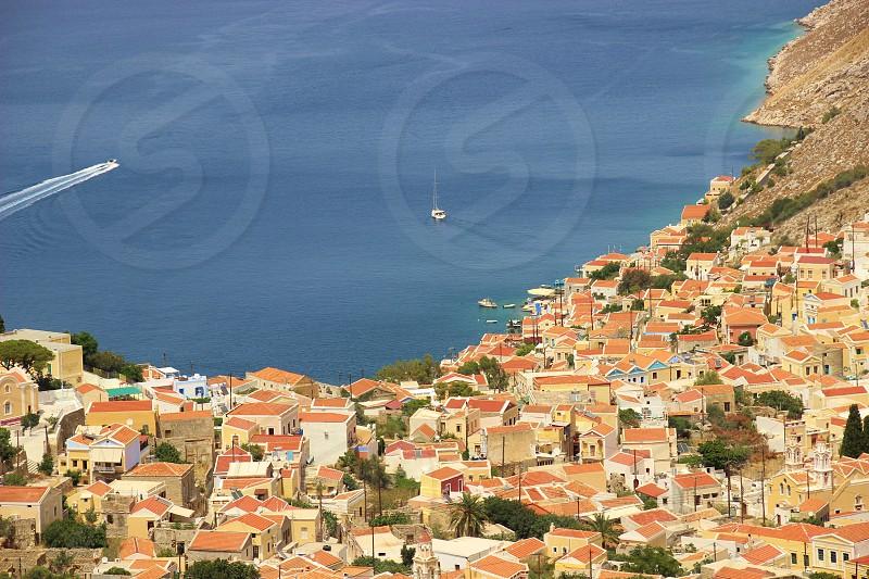 Greek Island of Symi Terracotta roof Greece Blue sea photo