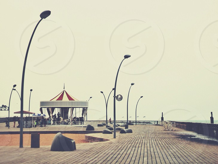 red and white carousel on wooden surface photo