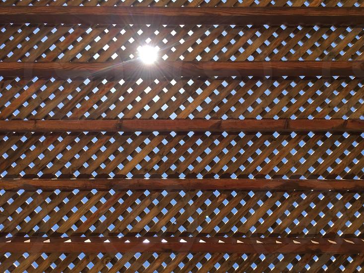 brown wooden lattice fence photo