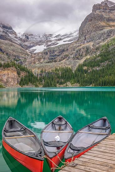 Canoes at Lake O'Hara. Autum in Yoho National Park. British Columbia. Canada photo