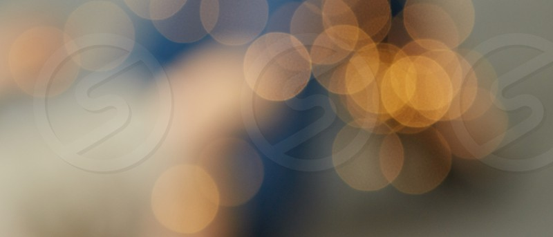 Golden lights bokeh. Blurred background of Christmas lights. Holiday postcard photo