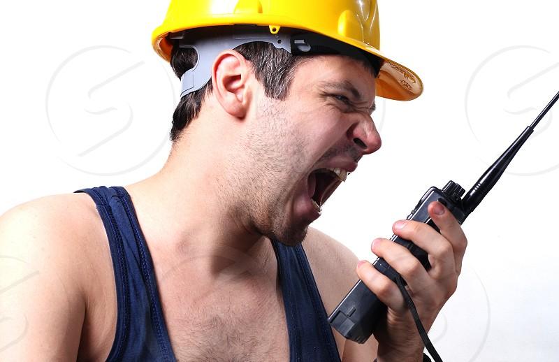 Worker yelling at radio photo